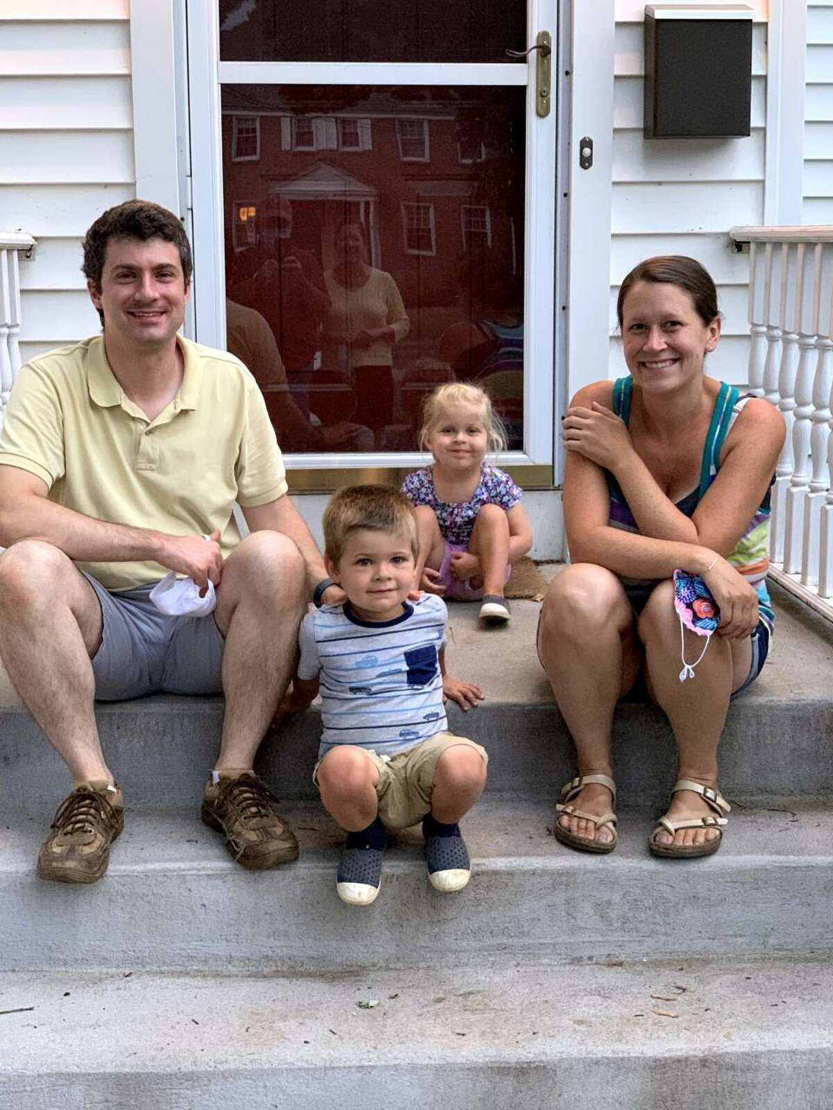 Jim and Emily Cornacchio of West Hartford, with their 3-year-old twins, Benjamin and Hailey.