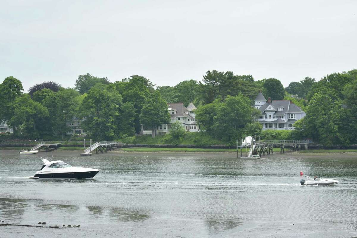 Boats pass a home on Glen Avon Drive (center left) in Greenwich, Conn., which is listed for sale for $4.5 million in June 2021.