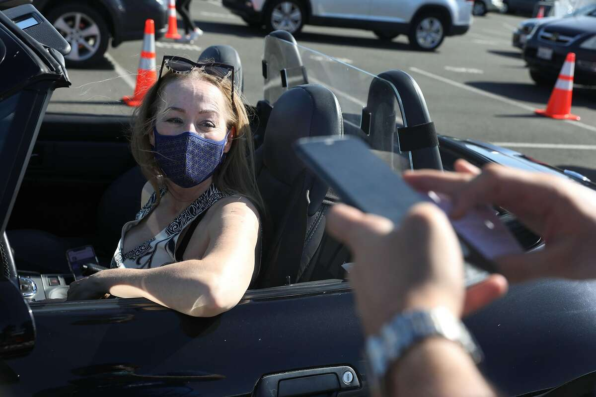 Kristina Skierka of Lucas Valley makes an appointment to complete her two-dose vaccination at Larkspur Ferry Terminal.