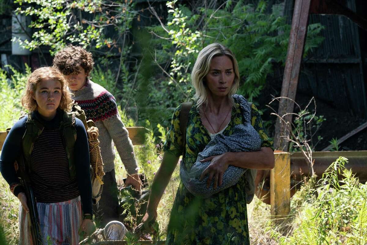 """Millicent Simmonds (from left), Noah Jupe and Emily Blunt brave the unknown in """"A Quiet Place Part II."""" (Jonny Cournoyer/Paramount Pictures/TNS)"""