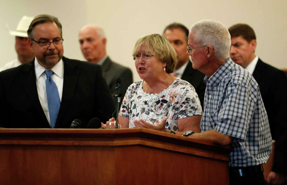Gay Smither with her husband, Bob, speak during a press conference held by Galveston County DA Jack Roady, to make an announcement in the William Reece investigation, Saturday, Jan. 1, 2016 in Galveston. Reece led investigators to the remains of two of his victims before being transferred to Oklahoma to face a murder charge. ( Karen Warren / Houston Chronicle )