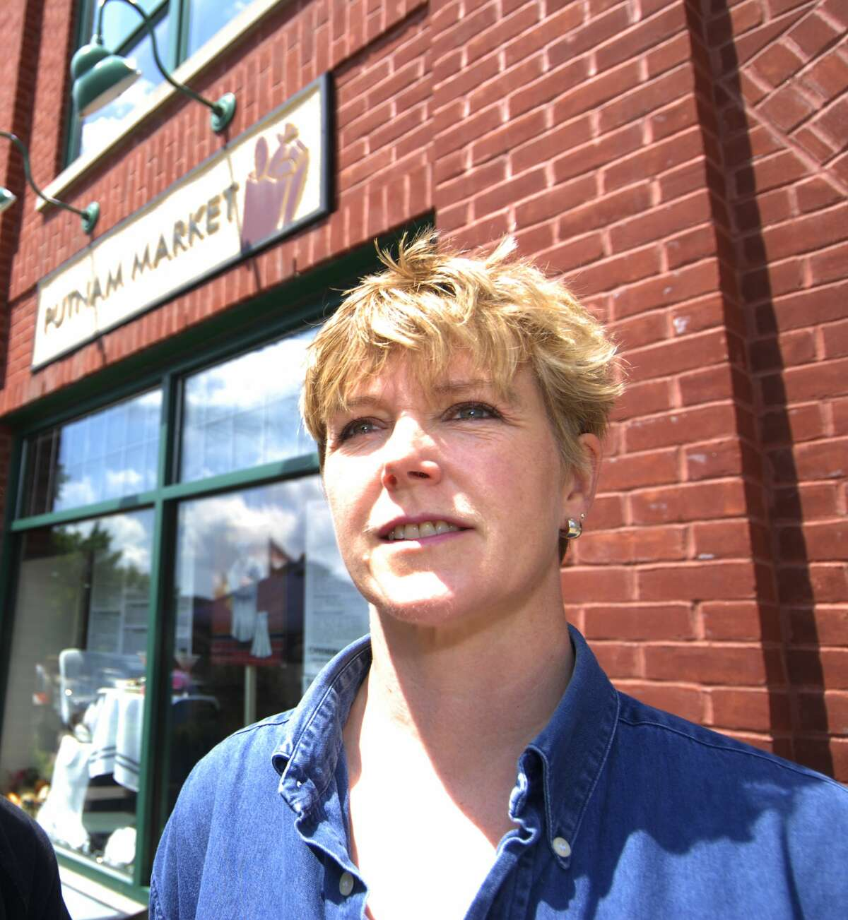 Putnam Market owner Catharine Hamilton in front of the store in June 2006. (Skip Dickstein/Times Union)