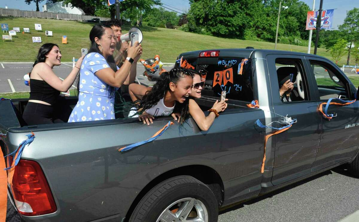 A pickup full of supporters cheer on Aaliyah Jade Alonso during the 2020 Danbury High School graduation, Wednesday, June 10, 2020, at Danbury High School, Danbury, Conn. Graduation is taking place over three days, June 10, 11, and 12.