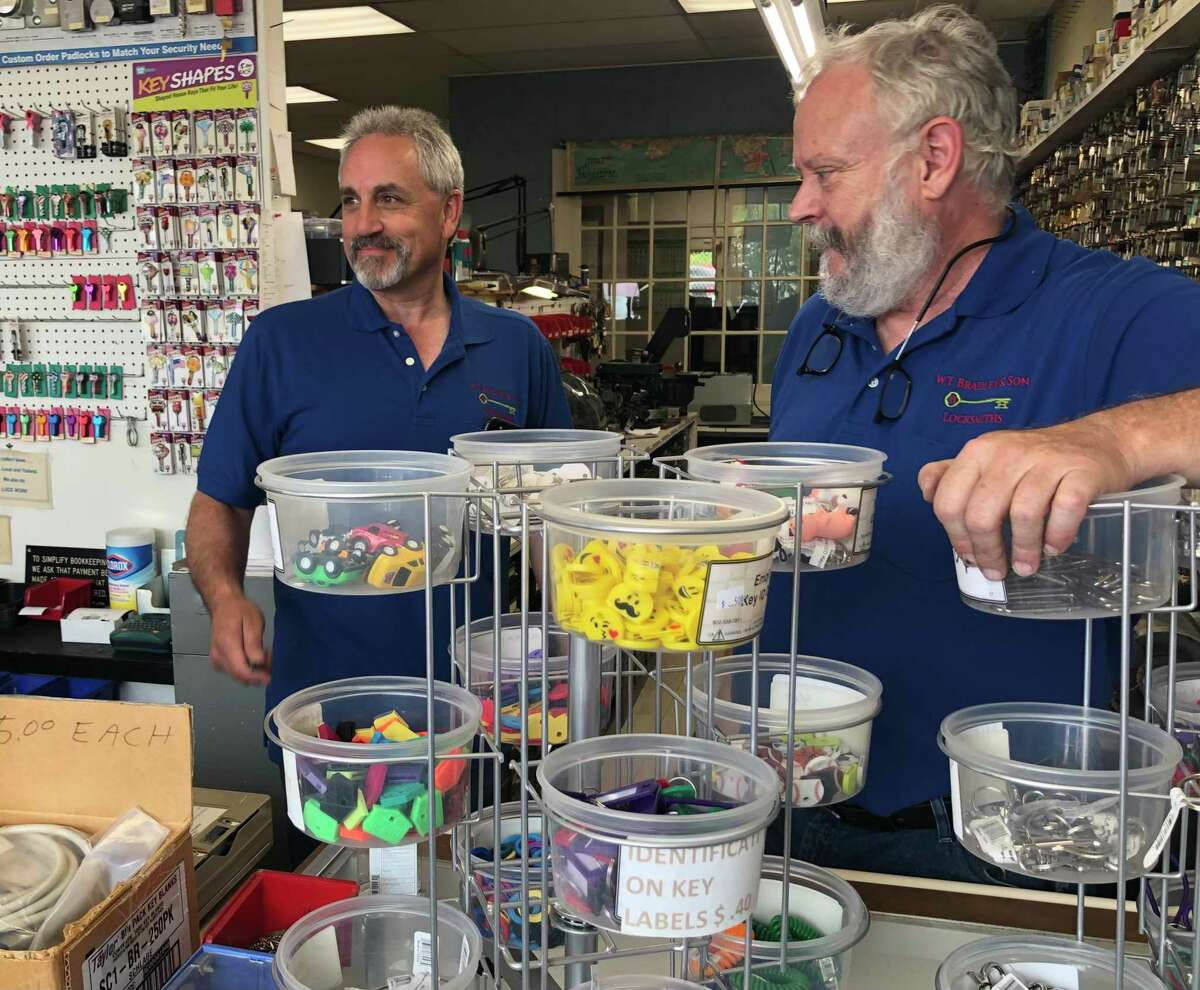 Rick Bayuk, the new owner of W.T. Bradley and Sons Locksmiths, and former owner Jack Bradley answer questions inside the business on Barnum Avenue in Stratford, Conn. June 1, 2021.