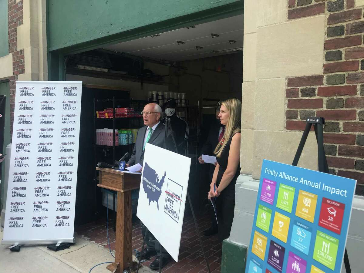 U.S. Rep. Paul Tonko, D-Amsterdam, speaks Tuesday June 1, 2021 outside the Arbor Hill Community Center Food Pantry at 47 Lark St. Albany, N.Y. as Natasha Pernicke, executive director of The Food Pantries of the Capital District listens.