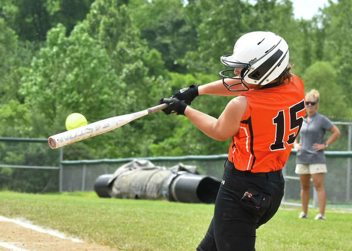 Edwardsville's Sydney Lawrence connects for an RBI base hit in the road win over Alton to close the regular season on Thursday.
