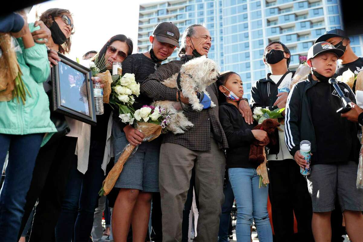 The family of Paul Megia mourns during a public vigil at San Jose City Hall for victims of last month's mass shooting.