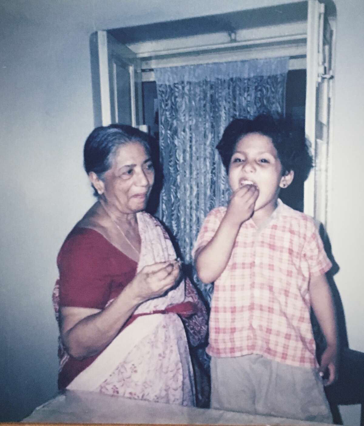 Getting a morsel from her grandmother was a special treat for Times Union arts and culture reporter Shrishti Mathew, seen here as a child.