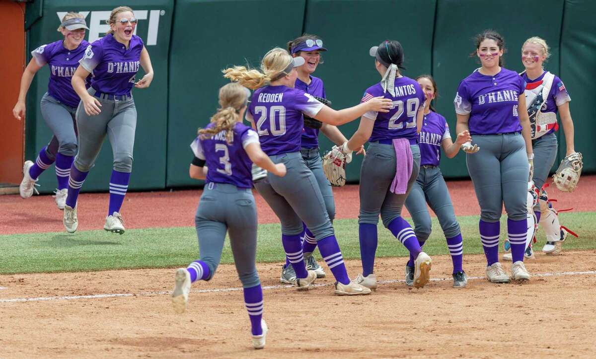 D'Hanis players rush Tuesday, June 1, 2021 in Austin, toward pitcher Marissa Santos after the last out in their 4-1 Division 1A state semifinal win over Gail Borden County at the UT softball field.