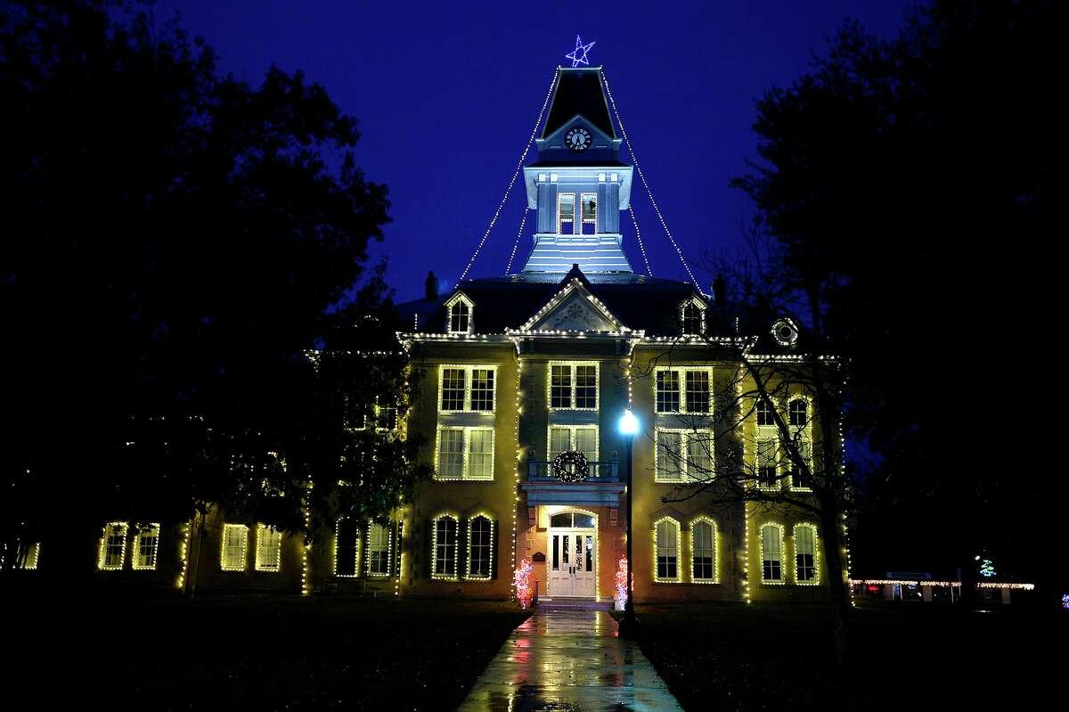 The historic Newton County Courthouse glows with Christmas lights. Photo taken Wednesday 12/6/17 Ryan Pelham/The Enterprise
