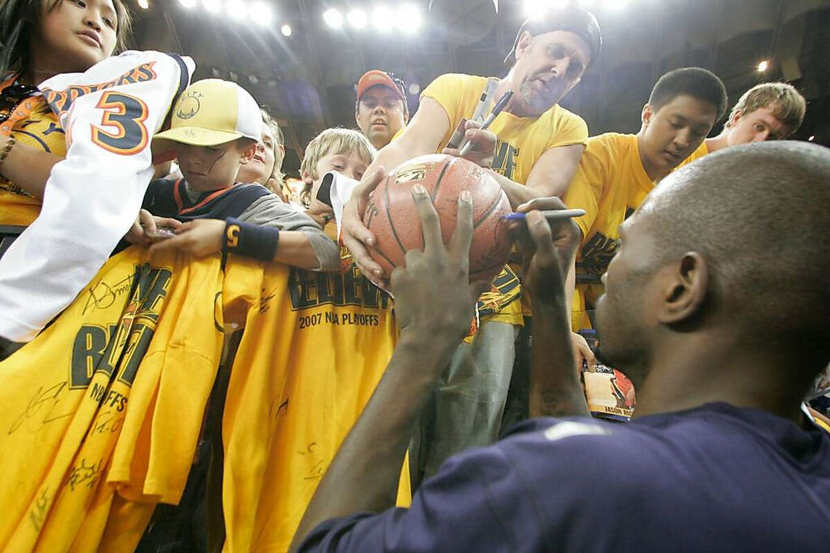 WARRIORS_GAME4_0119_KW.JPG Jason Richardson autographs a basketball for Mark Cooke from American Canyon after warming up prior to the game when Golden State Warriors play the Dallas Mavericks in playoff game #4 at Oracle Arena in Oakland on Friday April 29, 2007 . Kat Wade/The Chronicle