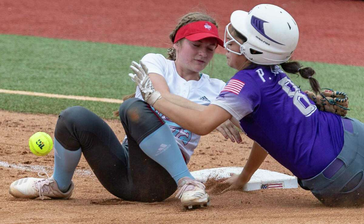 D'Hanis runner Peyton Burrell slides safely into third base Tuesday, June 1, 2021, at the UT Austin softball field after colliding with Gail Borden County third baseman Haddie Flanigan, who dropped the ball during the collision, during the Division 1A state semifinal game.