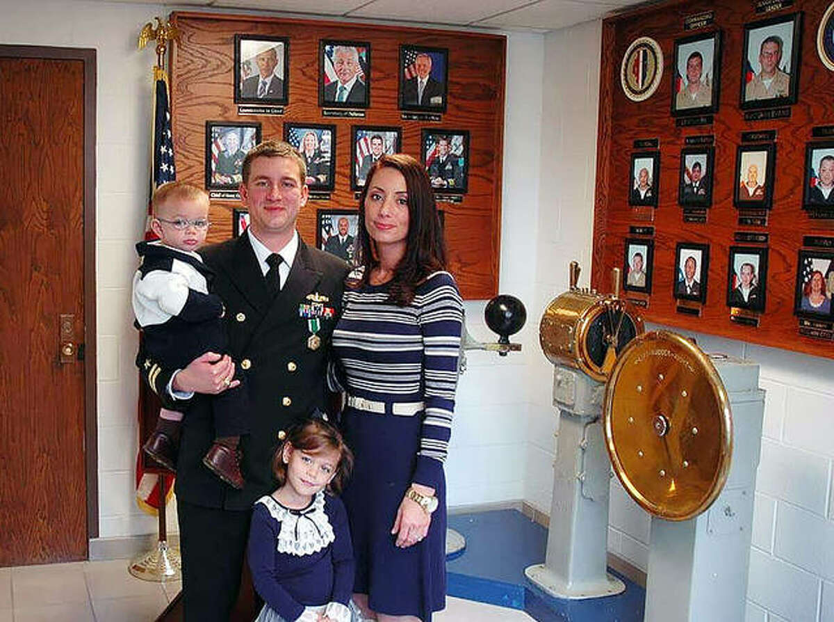 Edwardsville graduate Mike Modeer with his wife Hanna, son Jack and daughter Vivian during his last day of active U.S. Duty at Navy Operational Support Center Peoria in 2014.