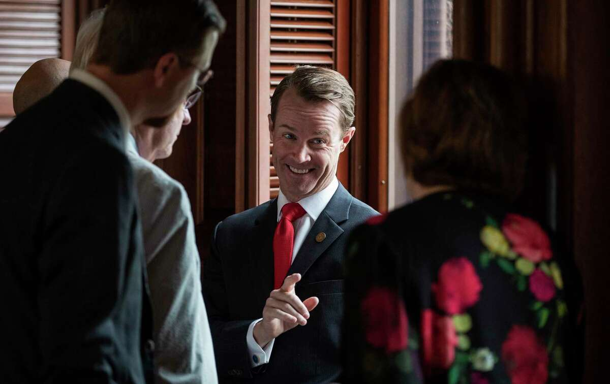 House Speaker Dade Phelan, R-Beaumont, talks to Republican members of the Texas House before the start of the debate of Senate Bill 7, known as the Election Integrity Protection Act, at the Capitol on Sunday May 30, 2021, in Austin, Texas. (Jay Janner/Austin American-Statesman via AP)