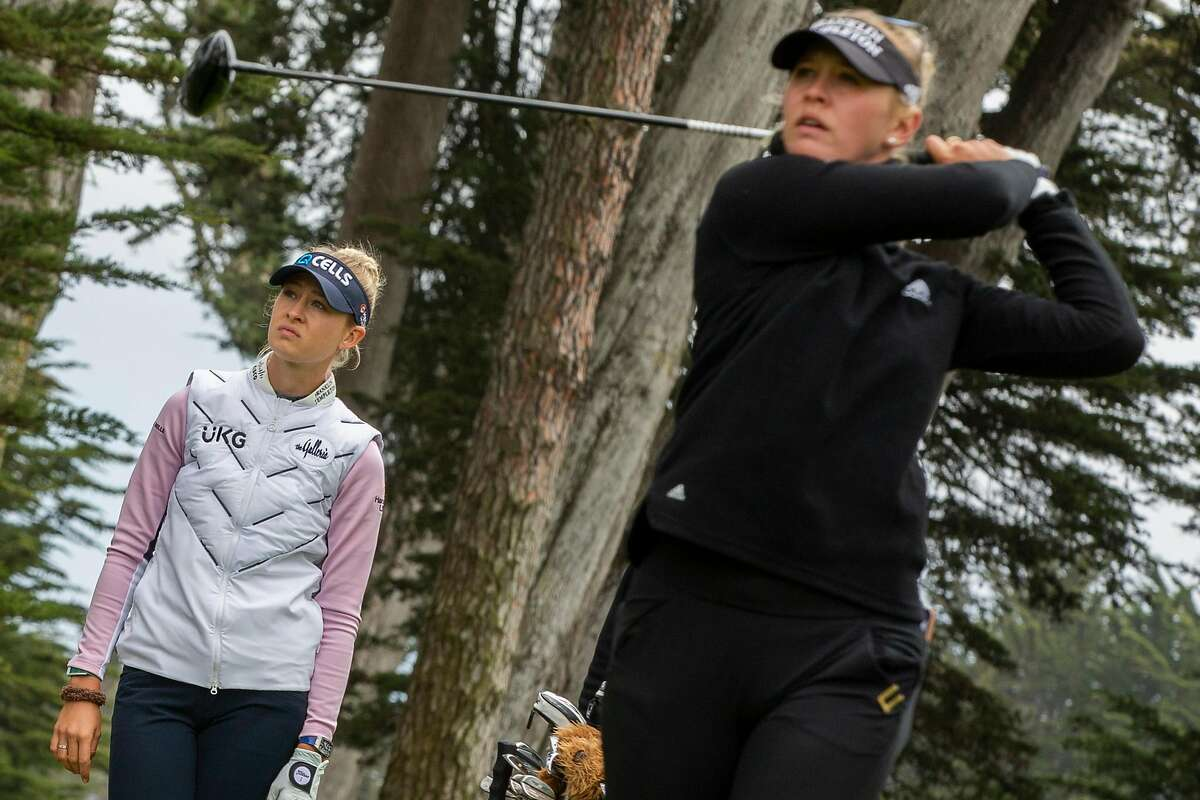 Jessica Korda (right) hits off the 10th tee as her sister, Nelly, waits her turn Tuesday at the Olympic Club. The Kordas will tee off at 8:28 a.m. in Thursday's first round.