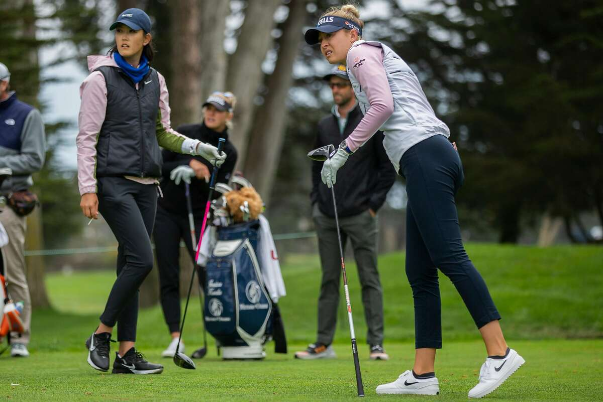 Nelly Korda (right) hits off the No. 10 tee as Michelle Wie West watches during Tuesday's practice round on the Lake Course.