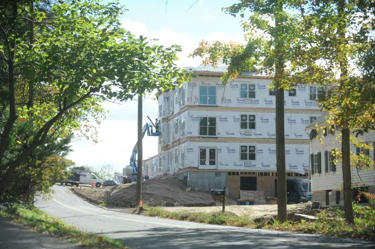 Laurel Hill Road in Brookfield is closed Oct. 8, 2014 as Dakota Parnters moves in modular units for the 72-unit