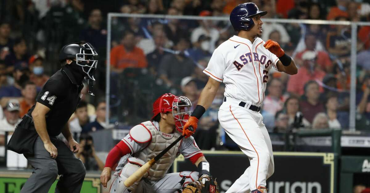 Houston Astros left fielder Michael Brantley (23) hits an RBI double during the eighth inning of an MLB baseball game at Minute Maid Park, Tuesday, May 11, 2021, in Houston.