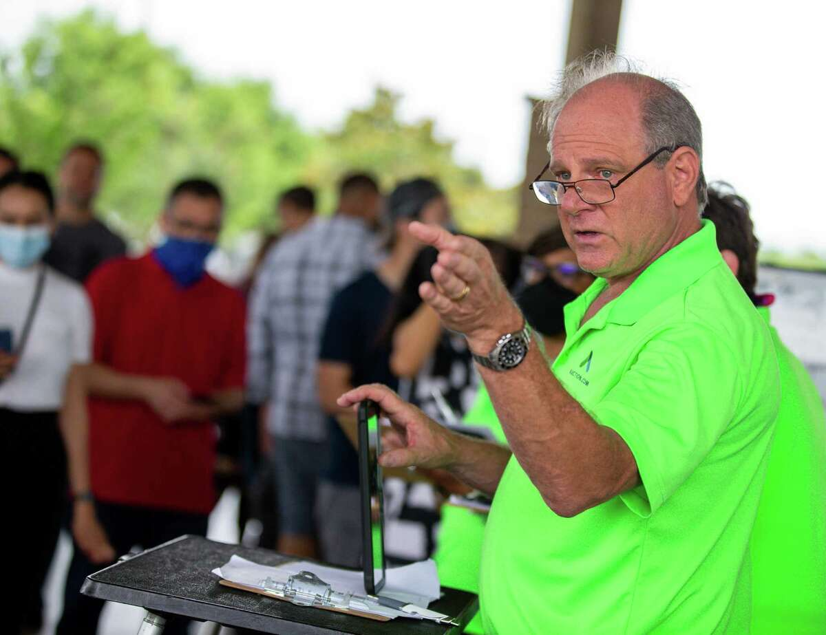 Auctioneer Carl Meyers asks for incoming bids during a Harris County foreclosure auction at the Bayou City Event Center on Tuesday, June 1, 2021, in Houston. Today was the first time the auction was operational since closing more than a year ago due to the pandemic.