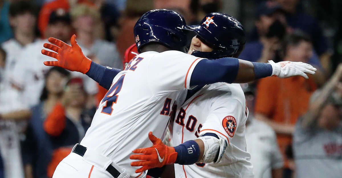 Houston Astros Yuli Gurriel (10) hugs Yordan Alvarez after hitting a three-run home run during the eighth inning of an MLB baseball game at Minute Maid Park, Tuesday, May 11, 2021, in Houston.