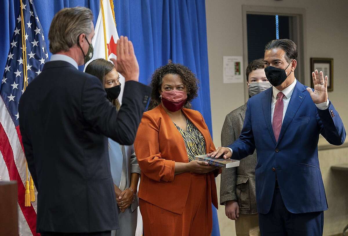 Mia Bonta (center) assists as as her husband, Rob Bonta, is sworn in as state attorney general by Gov. Gavin Newsom in April.