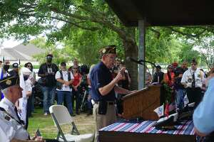 World War II Navy veteran Wilbur Duval speaks during a Memorial Day Program hosted by Katy Veterans of Foreign Wars Post 9182 on Monday, May 31, at Katy Magnolia Cemetery.