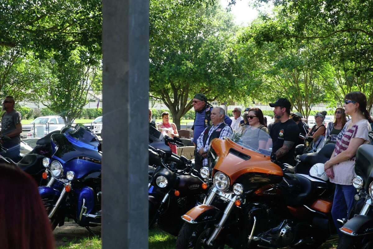 Motorcyclists look on during a Memorial Day program hosted by Katy Veterans of Foreign Wars Post 9182 on Monday, May 31, at Katy Magnolia Cemetery.