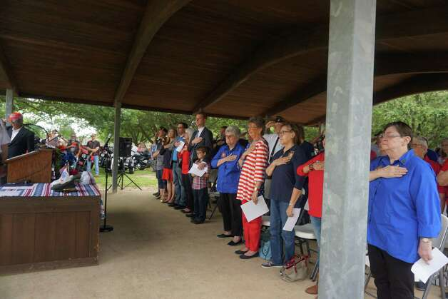 Attendees honor fallen United States veterans during a Memorial Day program hosted by Katy Veterans of Foreign Wars Post 9182 on Monday, May 31, at Katy Magnolia Cemetery. Photo: Tracy Maness / Staff Photo