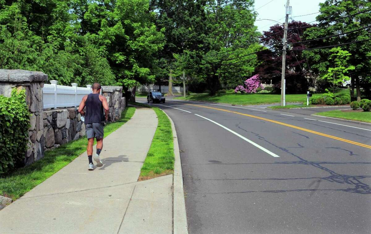 A view of North Street between Maple Avenue and Lita Drive in Greenwich, Conn., on Tuesday June 1, 2021. The Board of Selectmen is considering parking restrictions on this section of North Street. There is a safety concern about vehicles parked on the western side of the street causing a line of site issue for people leaving 7 and 9 North Street. If passed, this would restrict parking on both sides of this section betweeen Lita and Maple.