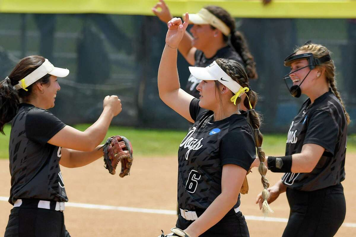 Kali Chatham, Chassety Raines and Ashlyn Strother celebrate TLU's Game 2 win Tuesday that forced Game 3, which they lost.