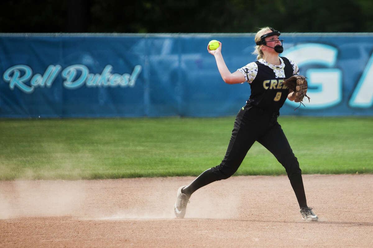 Bullock Creek's Hannah Borsenik throws to first base during a game against Bay City John Glenn Tuesday, June 1, 2021 at Essexville Garber High School. (Katy Kildee/kkildee@mdn.net)