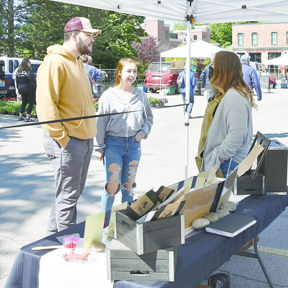 A couple stops to check out the wares at the Stohlistic Bison at the Manistee Farmers Market on Saturday.