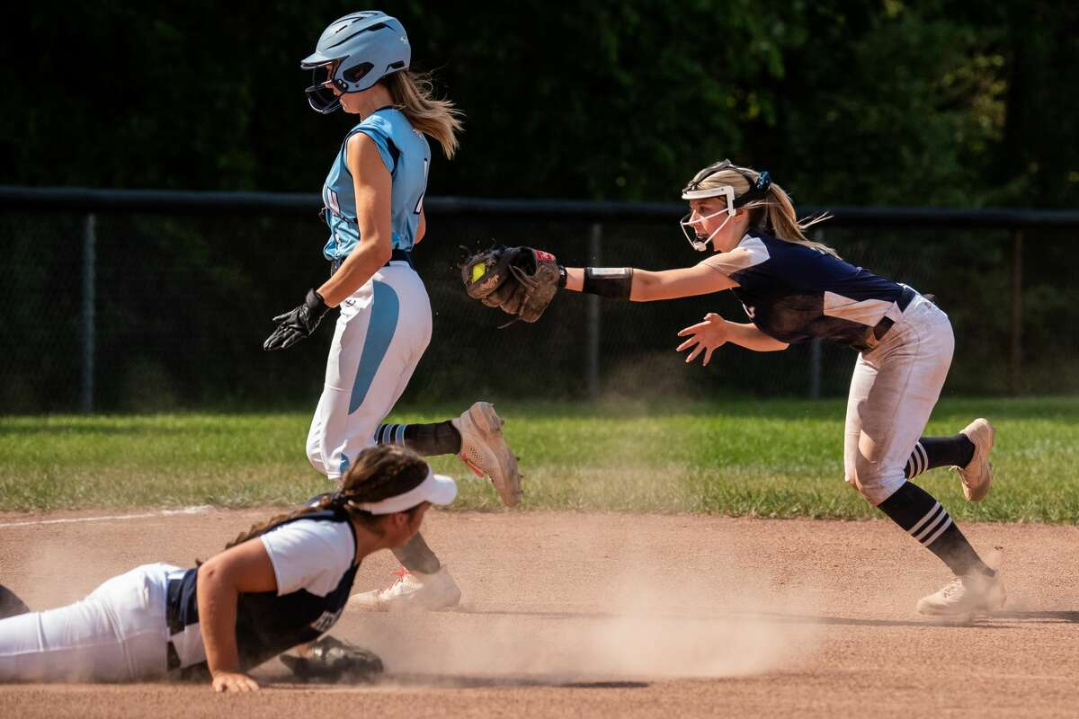 Meridian's Hailey Sadler avoids being tagged out during a first round district tournament game against Hemlock Tuesday, June 1, 2021 at Hemlock High School. (Isaac Ritchey/for the Daily News)