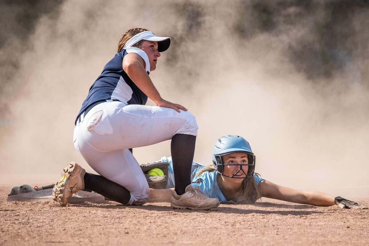 Meridian's Hailey Sadler slides into third base during a first round district tournament game against Hemlock Tuesday, June 1, 2021 at Hemlock High School. (Isaac Ritchey/for the Daily News)