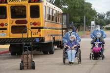 Medical personnel assist the elderly as they are put on a handicap accessible bus at the Bob Bowers Civic Center as evacuations begin Tuesday in Port Arthur. Photo taken Tuesday, August 54, 2020 Kim Brent/The Enterprise