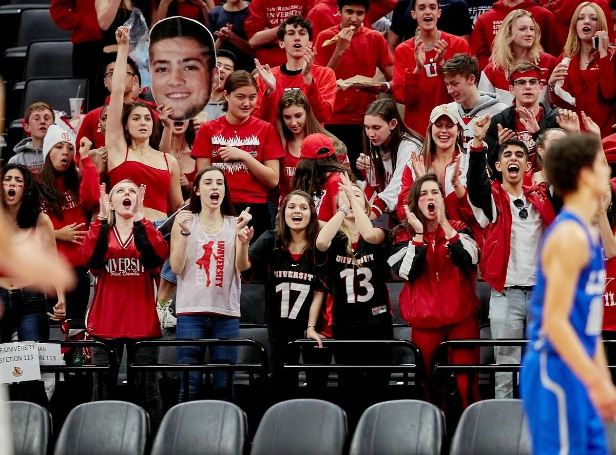 University fans cheer on their team in the 2019 state Division III title game. University lost that game to La Jolla Country Day, 67-39, but with a young team led by 6-5 Joey Kennedy, the Red Devils could return to the title game next season.