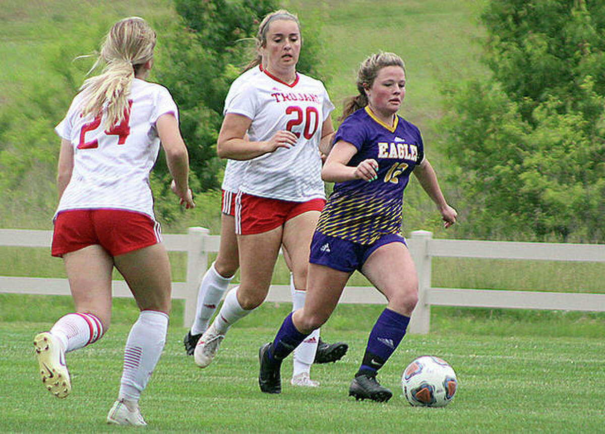 Aubree Wallace of Civic Memorial moves the ball against Charleston in Tuesday's IHSA Class 2A sub-sectional first-round game at the Bethalto Sports Complex. Wallace scored three goals in her team's 7-0 victory.