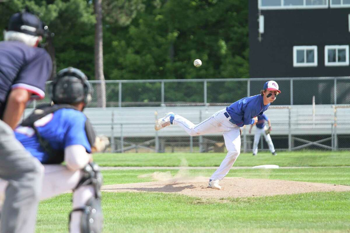 Manistee Catholic Central senior Blake Johnson delivers a pitch during the Sabers' victory over Brethren on Tuesday in a Division 4 district quarterfinal. (Dylan Savela/News Advocate)