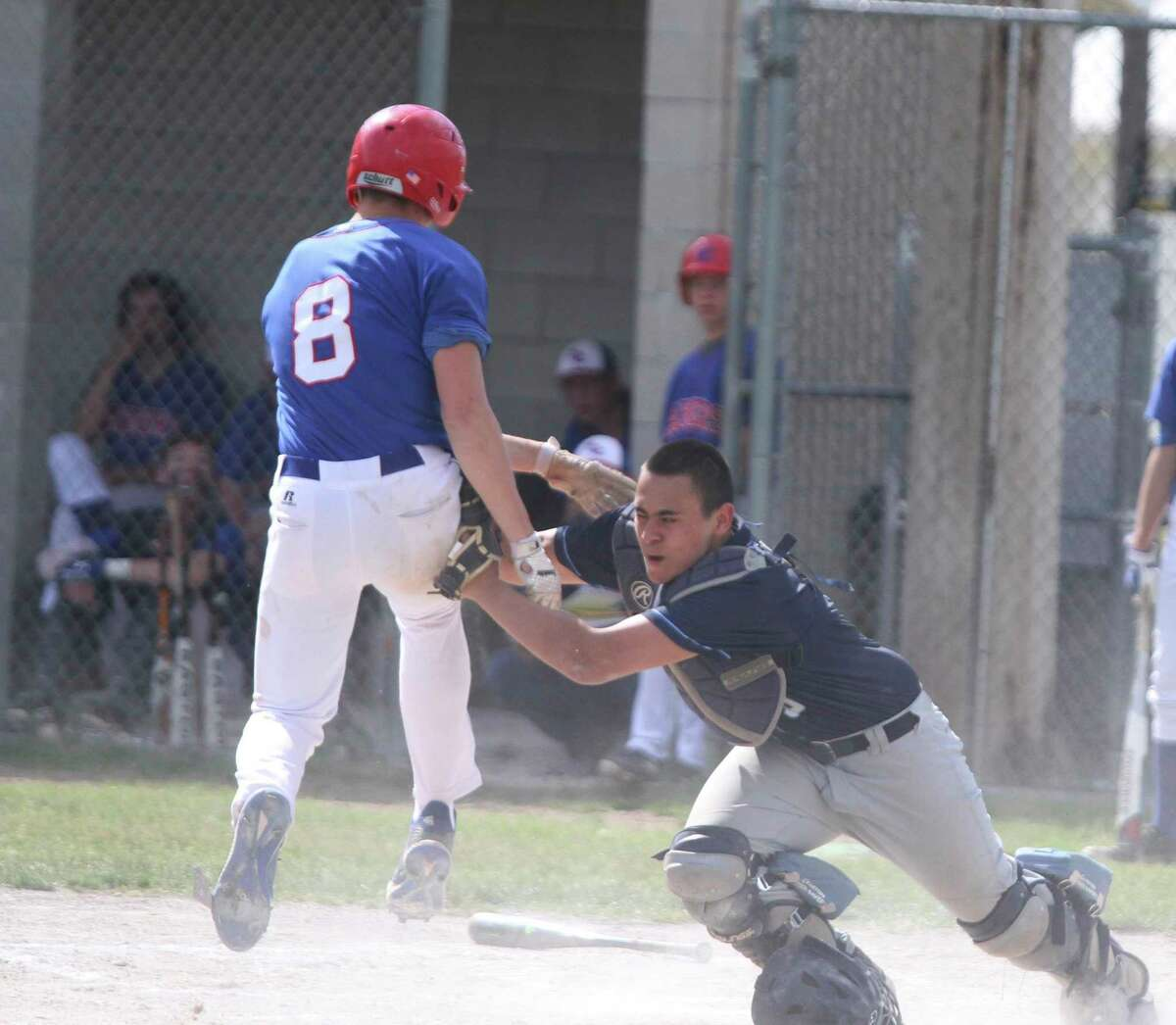 Brethren catcher Adam Dull tags out MCC's Adam Pierce at home plate during a Division 4 district quarterfinal in Mesick. (Dylan Savela/News Advocate)