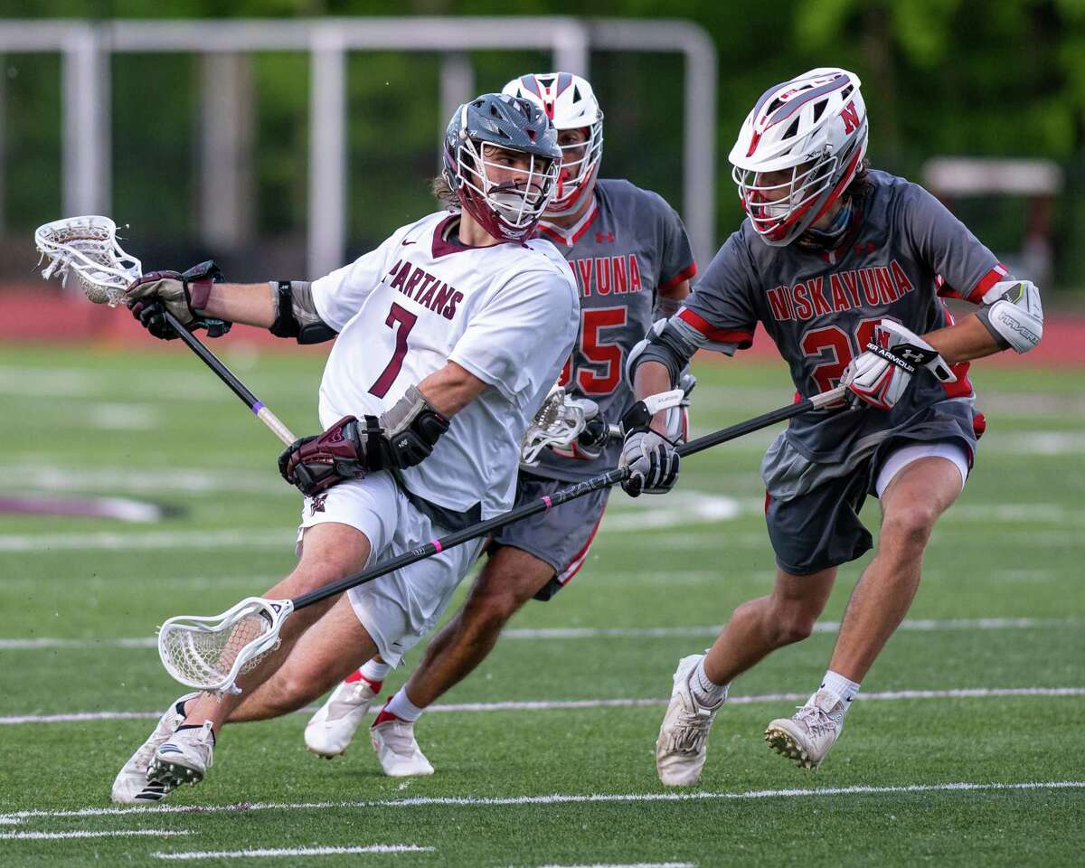 Burnt Hills Ballston Lake midfielder Caeden LaPietro winds up a shot in front of Niskayuna defenders Leo O'Brien (left) and Colin Meade during a Suburban Council matchup. The University at Albany-bound standout finished with three goals and three assists as the Spartans defeated Ballston Spa 15-9 in the Section II Class B final.