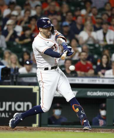Houston Astros Carlos Correa (1) hits into a double play during the third inning of an MLB baseball game at Minute Maid Park, Tuesday, June 1, 2021, in Houston. Photo: Karen Warren/Staff Photographer / @2021 Houston Chronicle
