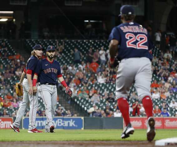 Boston Red Sox starting pitcher Garrett Richards (43) turns to congratulate Marwin Gonzalez (12) and Danny Santana (22) after their defense as Houston Astros Alex Bregman ground out during the third inning of an MLB baseball game at Minute Maid Park, Tuesday, June 1, 2021, in Houston. Photo: Karen Warren/Staff Photographer / @2021 Houston Chronicle