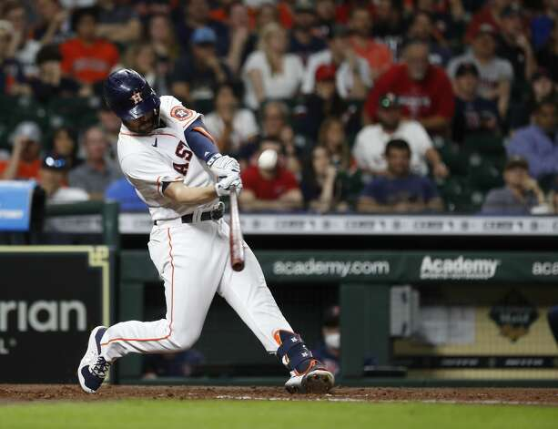 Houston Astros Chas McCormick (20) hits a sacrifice fly allowing Yordan Alvarez to score a run during the fourth inning of an MLB baseball game at Minute Maid Park, Tuesday, June 1, 2021, in Houston. Photo: Karen Warren/Staff Photographer / @2021 Houston Chronicle