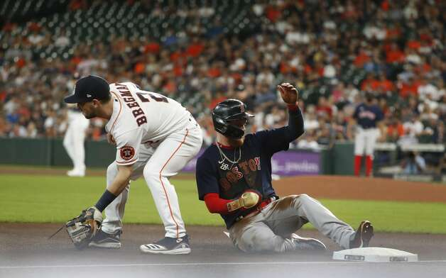 Boston Red Sox Alex Verdugo (99) slides into third base after stealing second base and advanced to third on a throwing error by Houston Astros catcher Martin Maldonado during the first inning of an MLB baseball game at Minute Maid Park, Tuesday, June 1, 2021, in Houston. Photo: Karen Warren/Staff Photographer / @2021 Houston Chronicle