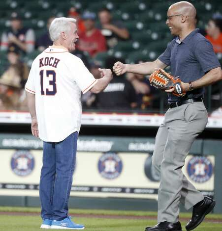 Tom Koch, who recently retired from Channel 13, greets Astros radio broadcaster, Robert Ford after throwing out the first pitch before the start of the first inning of an MLB baseball game at Minute Maid Park, Tuesday, June 1, 2021, in Houston. Photo: Karen Warren/Staff Photographer / @2021 Houston Chronicle