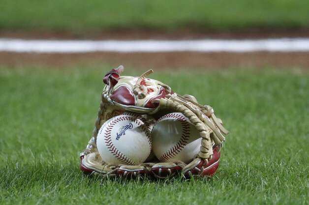 A glove and baseballs on the field before the start of the first inning of an MLB baseball game at Minute Maid Park, Tuesday, June 1, 2021, in Houston. Photo: Karen Warren/Staff Photographer / @2021 Houston Chronicle
