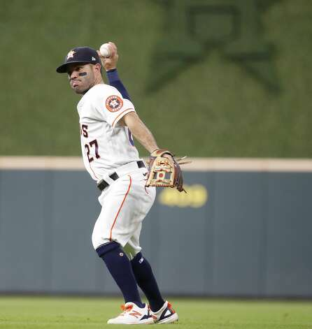 Houston Astros second baseman Jose Altuve (27) makes a spinning catch as he fielded Boston Red Sox left fielder Alex Verdugo's ground ball for the final out in the top of the third inning of an MLB baseball game at Minute Maid Park, Tuesday, June 1, 2021, in Houston. Photo: Karen Warren/Staff Photographer / @2021 Houston Chronicle