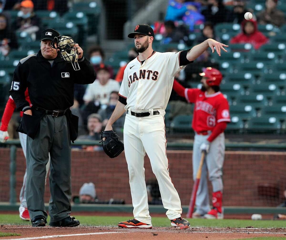 Alex Wood (57) tosses the ball after giving up a run on a wild pitch in the third inning as the San Francisco Giants played the Los Angeles Angels at Oracle Park in San Francisco, Calif., on Tuesday, June 1, 2021.