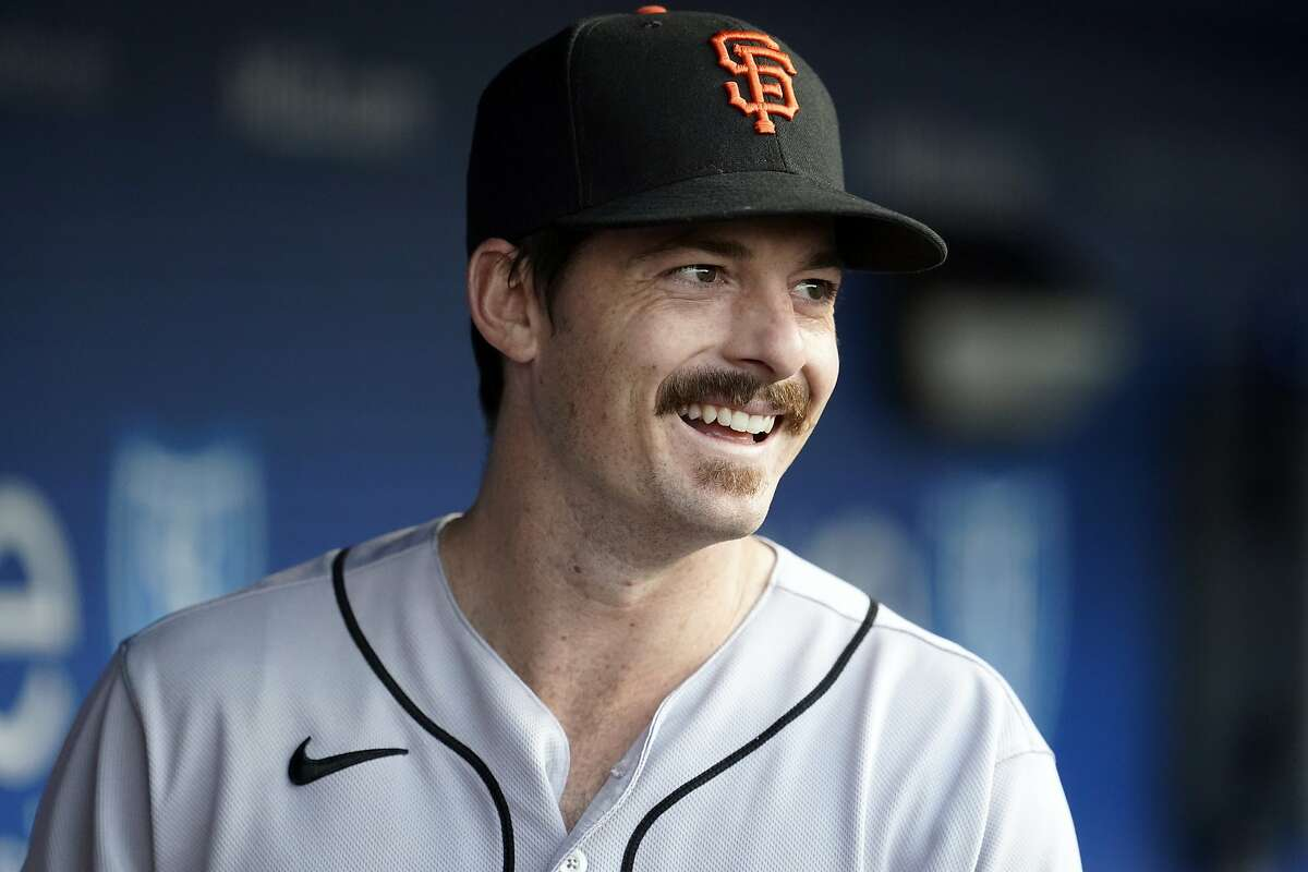San Francisco Giants' Mike Yastrzemski looks on from the dugout during a baseball game against the San Francisco Giants Friday, May 28, 2021, in Los Angeles. (AP Photo/Marcio Jose Sanchez)