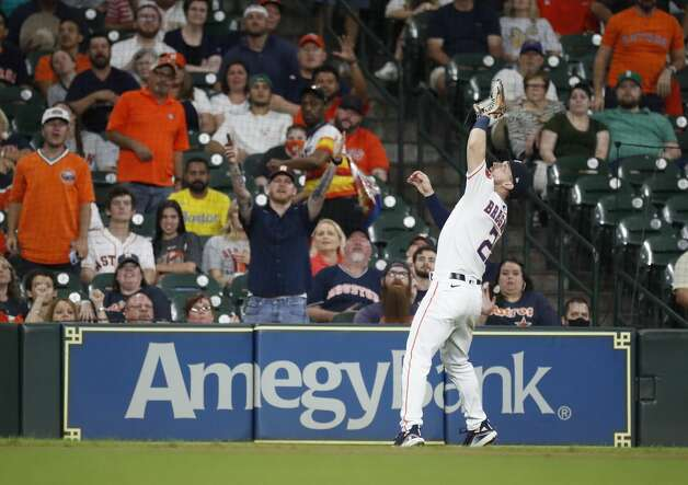Houston Astros third baseman Alex Bregman (2) catches Boston Red Sox Enrique Hernandez's pop out during the fifth inning of an MLB baseball game at Minute Maid Park, Tuesday, June 1, 2021, in Houston. Photo: Karen Warren/Staff Photographer / @2021 Houston Chronicle